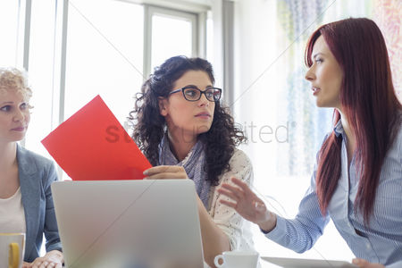 Women : Creative businesswomen discussing in meeting at office