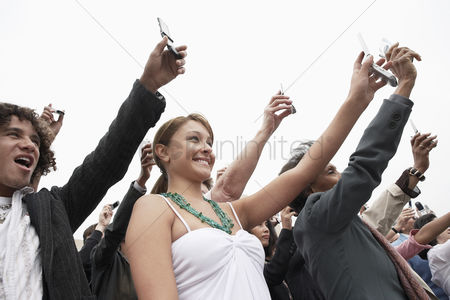 Demonstration : Crowd holding up cell phones half length