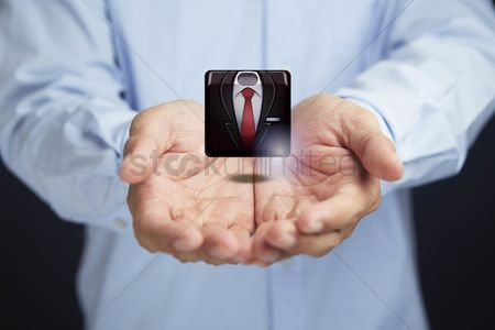 Man suit fashion : Cupped hands presenting business suit icon