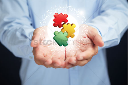 Match : Cupped hands with colorful puzzles