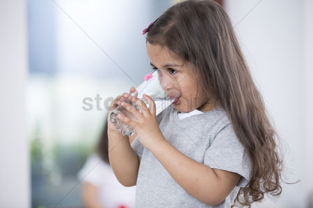 Czech republic : Cute girl drinking glass of water at home