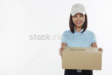 Malaysian chinese : Delivery person carrying a cardboard box