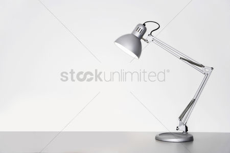 Technology background : Desk lamp on table over white background