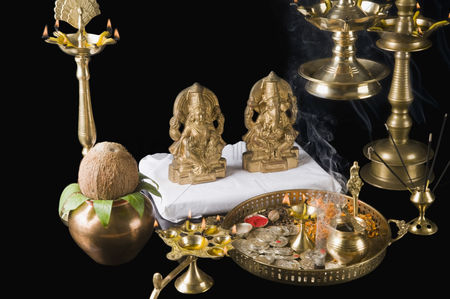 God : Diwali thali in front of idols of lord ganesha and goddess lakshmi