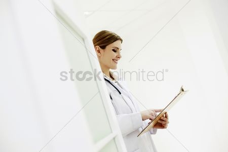 China : Doctor reading document on clipboard