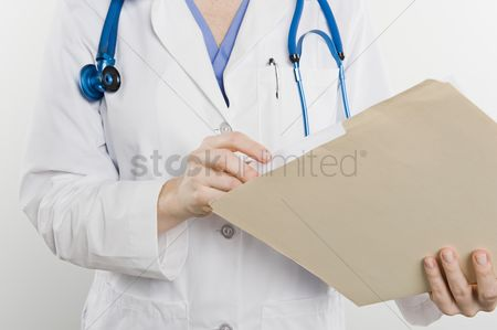 Background : Doctor with medical file mid section
