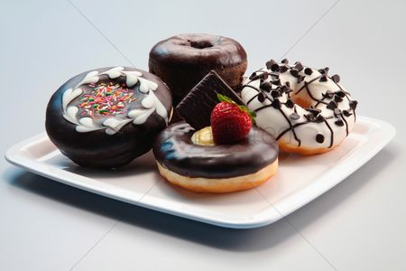 Ready to eat : Donuts with icing on a plate