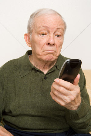 Sullen : Elderly man with remote control