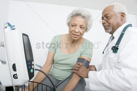 Examination : Elderly woman and senior practitioner during medical check-up