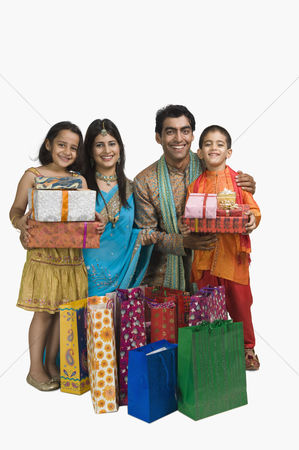 Diwali : Family holding shopping bags and gifts for diwali