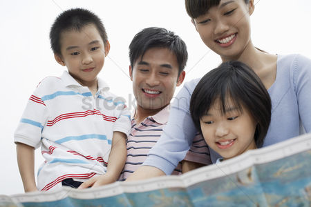 White hair : Family including boy and girl  7-9  reading map outdoors