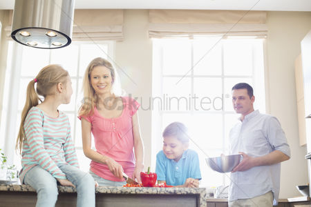 Three quarter length : Family preparing food in kitchen