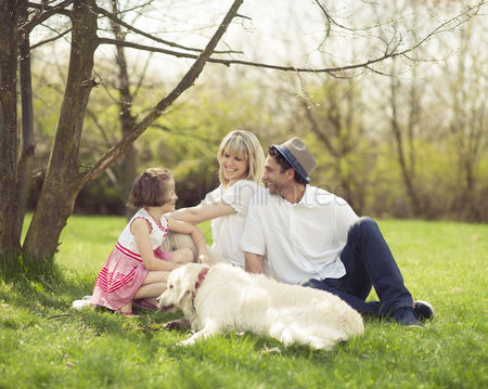 Czech republic : Family sitting in park with dog