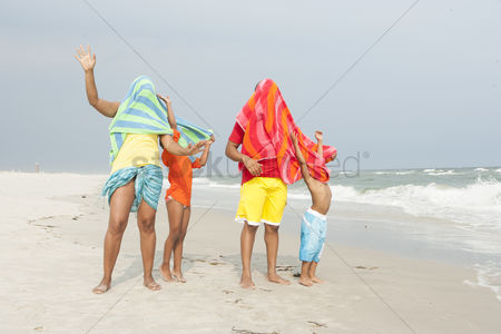 2092606 Family Funny With Beach Towels On