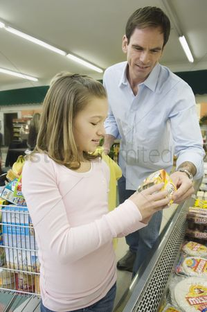 Supermarket : Father and daughter shop together in supermarket