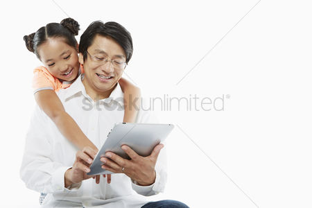 Daughter : Father and daughter using a digital tablet together
