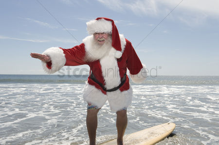 Jacket : Father christmas surfboards at the waters edge
