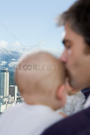 Kissing : Father kissing his sons head