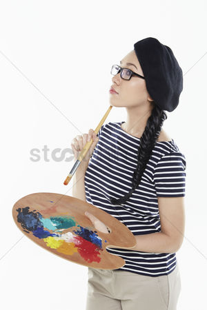 Paint brush : Female artist holding a paint brush and palette