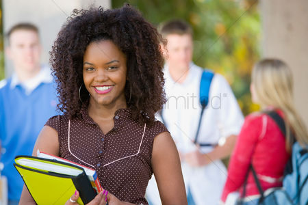 High school : Female student smiling outdoors  portrait