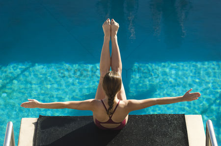 Diving : Female swimmer sitting on diving board