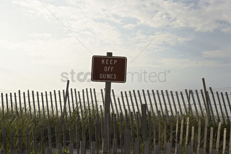 Forbidden : Fence and sign reading  keep off dunes