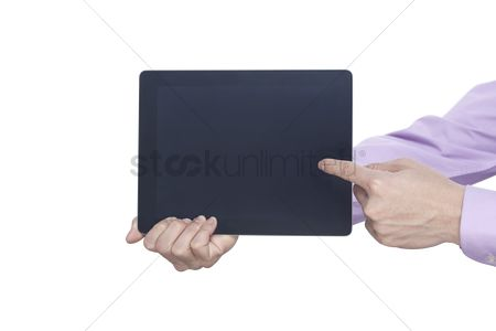 Devices : Finger pointing at a digital tablet