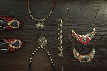 Accessories : Flat lay of tribal accessories on wooden background