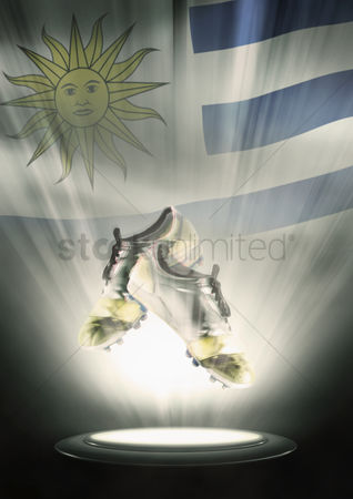 Nationality : Football cleats with uruguay flag backdrop