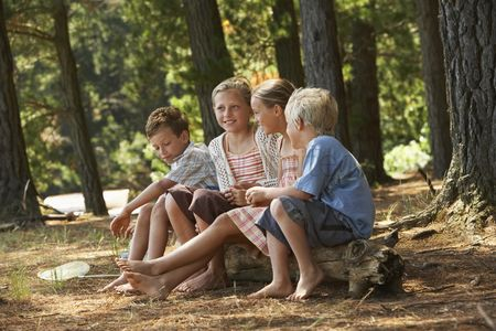 Friends : Four children in forest