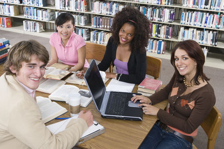 University : Four university students studying in library