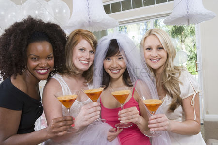 Celebrating : Friends drinking cocktails at bridal shower