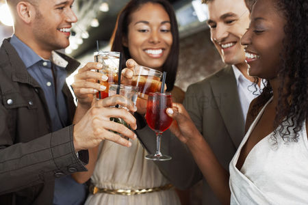 Appearance : Friends toasting standing at bar