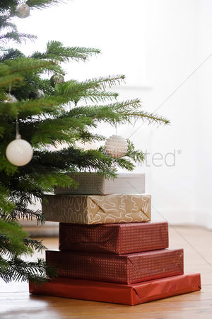 Bliss : Gifts piled under a christmas tree
