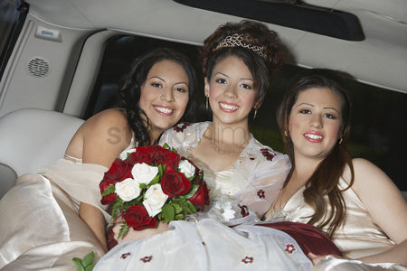 Hispanic : Girl  13-15  with friends in limousine at quinceanera