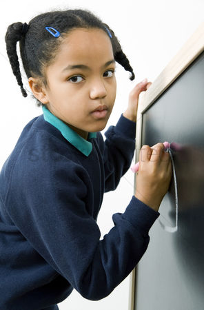 Pupil : Girl drawing on chalkboard