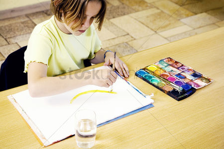 School children : Girl painting with brush