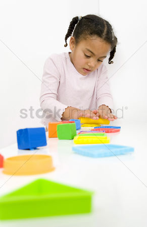 Children playing : Girl playing with clay