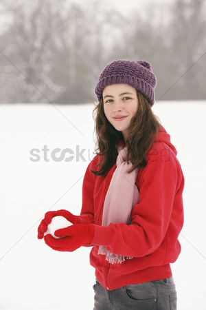 Cold temperature : Girl playing with snowball