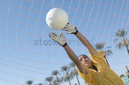 Pitch : Girl reaching for soccer ball