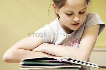 School children : Girl reading book