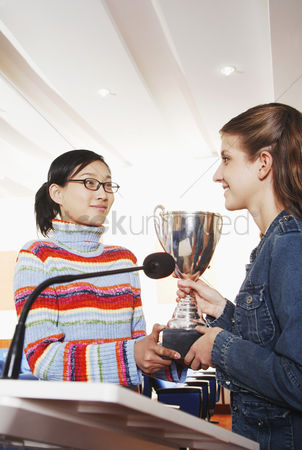 Bespectacled : Girl receiving her award