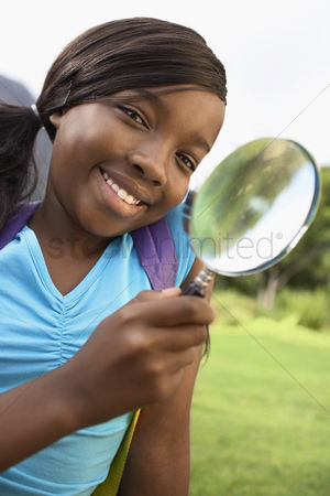 Posed : Girl using magnifying glass