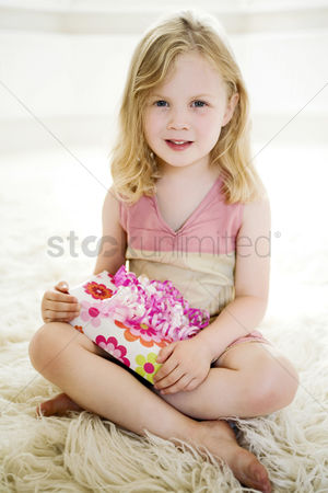 Celebrating : Girl with a present on her lap