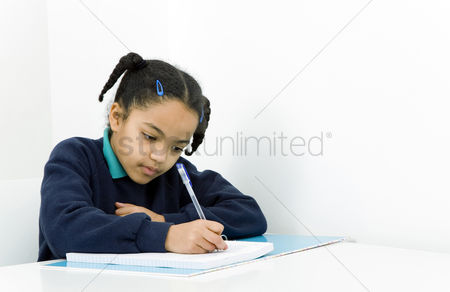Educational : Girl writing on paper