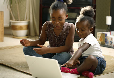 Children : Girls using laptop