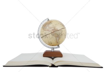 Show : Globe stand on an opened book