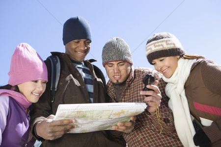 Women group outside : Group of friends stand looking at map together