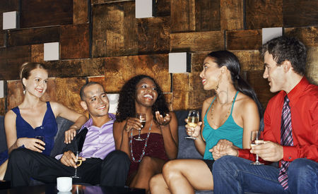 Friend : Group of friends talking sitting on couch in bar