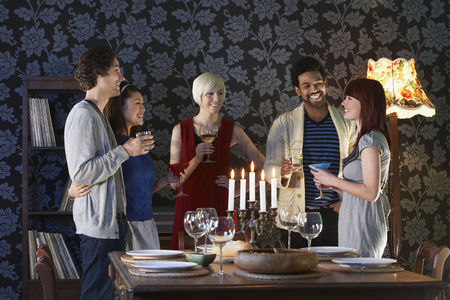 Friends : Group of people smiling standing by dining table